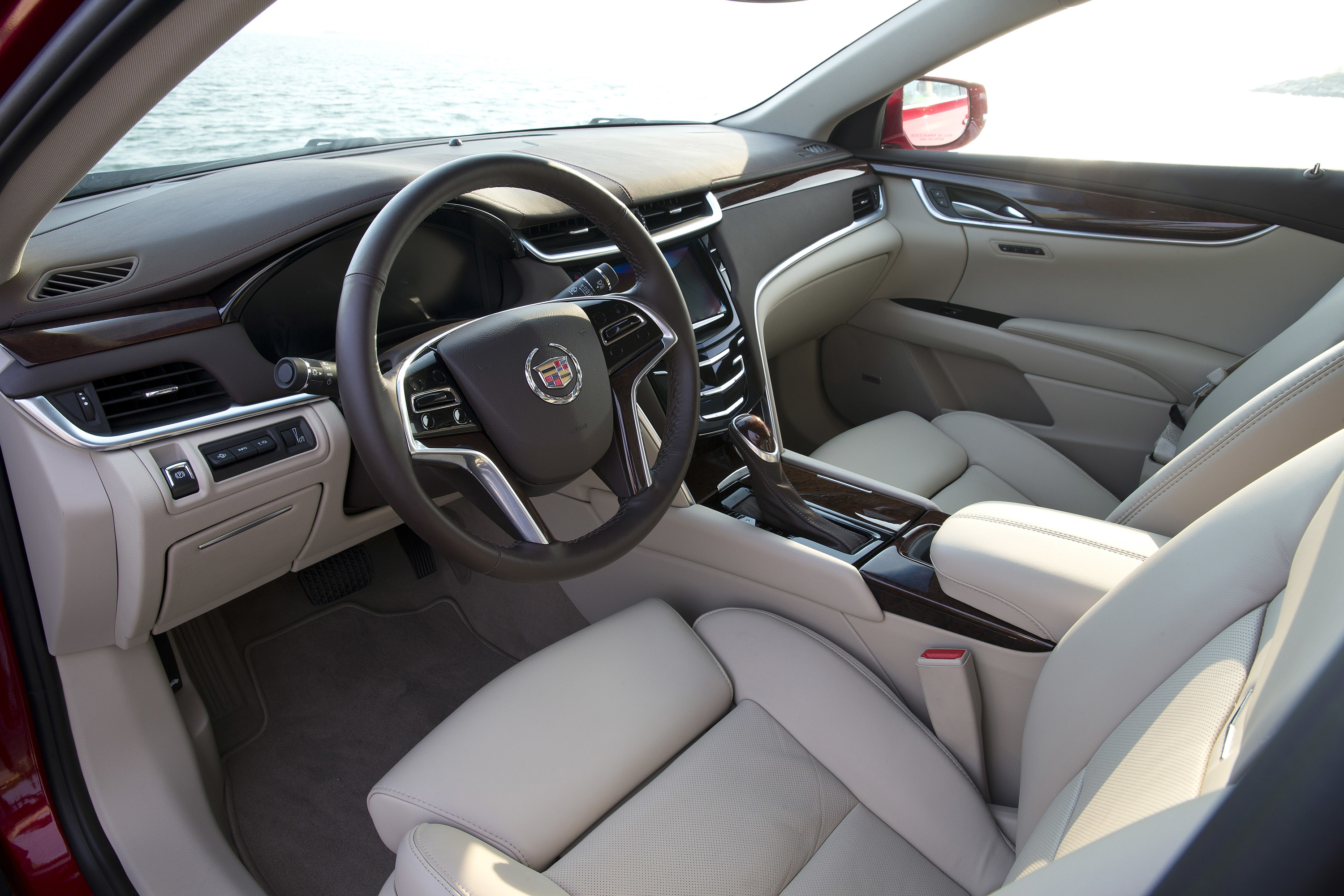 dark car woman a blue ats buying img at featured cadillac model adriatic retails msrp as for in the coupe xts jouelzy single metallic